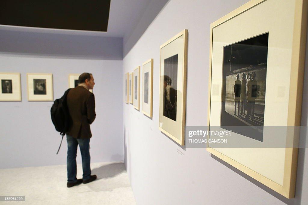 A man watches photographs of Brassai during the exhibition entitled 'Brassai, pour l'amour de Paris' ('Brassai, for the love of Paris') at the Hotel de Ville of Paris, on November 6, 2013.