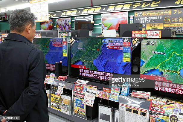 A man watches television sets broadcasting the news of the North Korea's hydrogen bomb test on January 6 2016 in Tokyo Japan The Korea Meteorological...