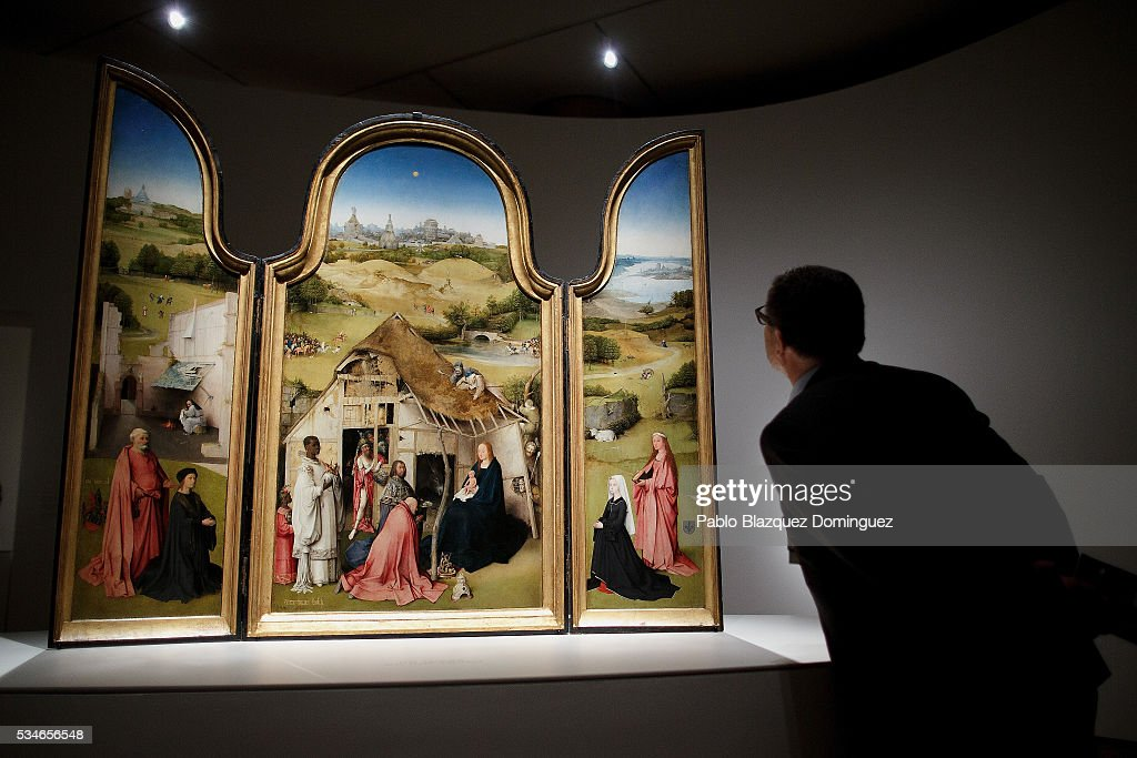 A man watches 'The adoration of the magi triptych' from Dutch painter Hieronymus Bosch during a press preview at El Prado Museum on May 27, 2016 in Madrid, Spain. The Prado Museum holds the 'El Bosco' (Hieronymus Bosch) painter major exhibition to celebrate the fifth century anniversary of the Dutch artist's death (ca. 1450-1516) featuring sixty five works from various Spanish and global museums.