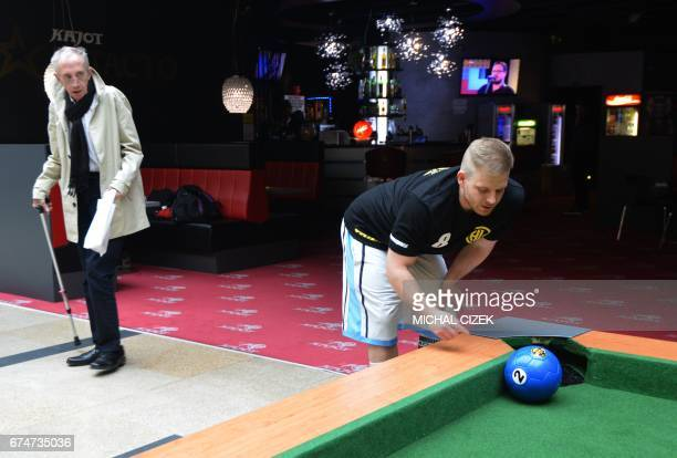 A man watches the ball during a footballpool match on April 28 2017 in Prague Footballpool is a combination of football and pool the sport uses...