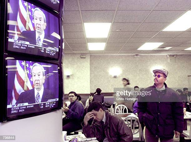 A man watches Warren Christopher give a statement on a bank of television screens in a Burger King November 17 2000 in New York The Florida Supreme...