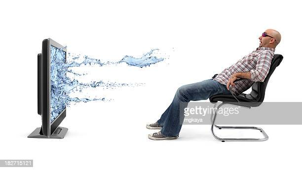 A man watching a 3-D television isolated on white