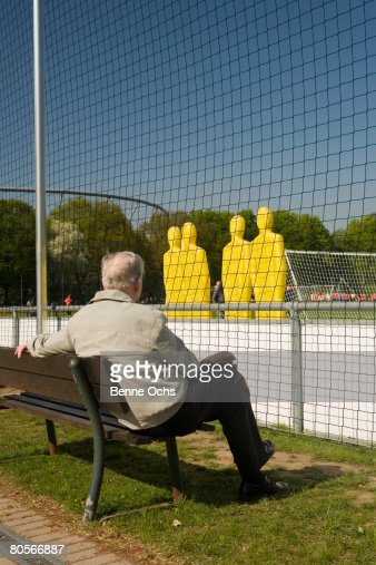 A man watching a football practice