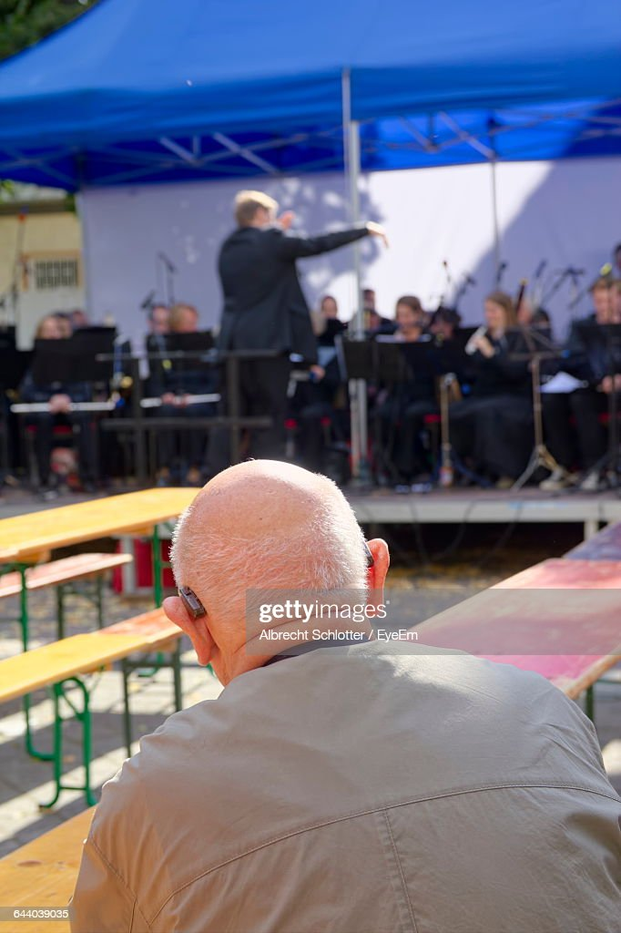 Man Watching Orchestra Performance