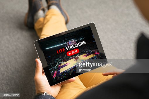 Man watching sports on live streaming online service : Stock Photo