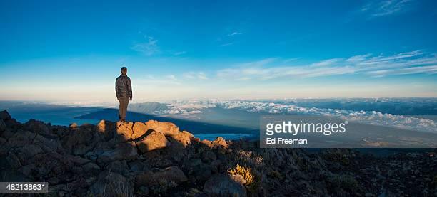 Man Watching Sunrise on Mountaintop