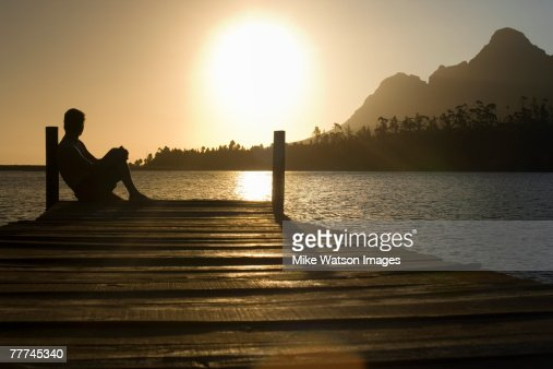 Man Watching Sunset over Lake : Stock Photo