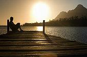 Man Watching Sunset over Lake