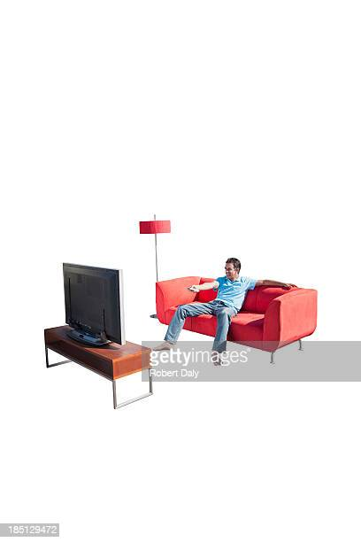A man watching television on a couch