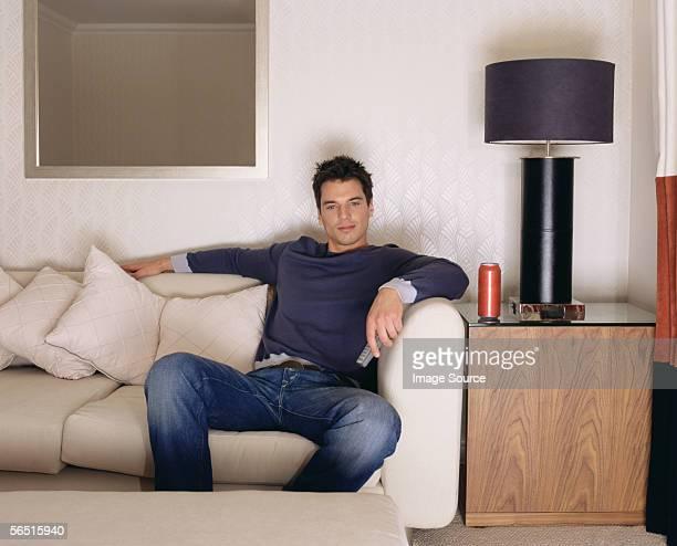 Man watching television on sofa