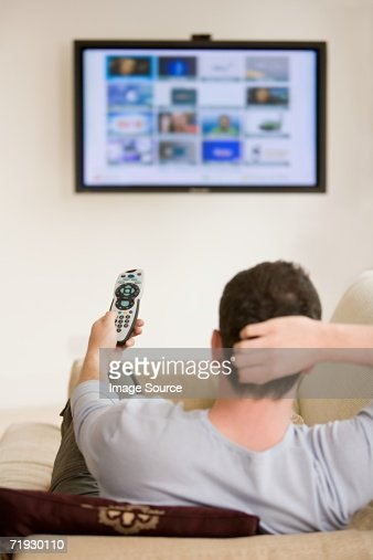Man watching television : Stock Photo