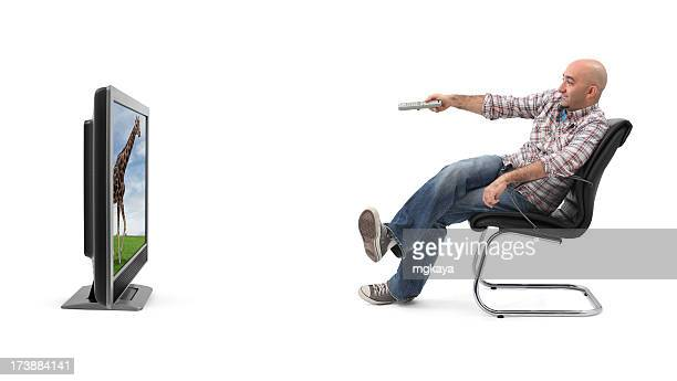 A man watching television with a remote