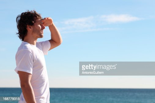 Man watching the sea : Stock Photo