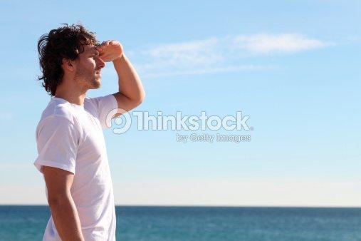 Man watching the sea : Stock Photo