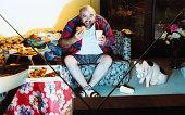 Man watching tv and eating junk food