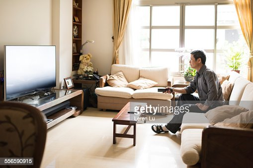 Tv In Living Room man watching tv in living room stock photo | getty images