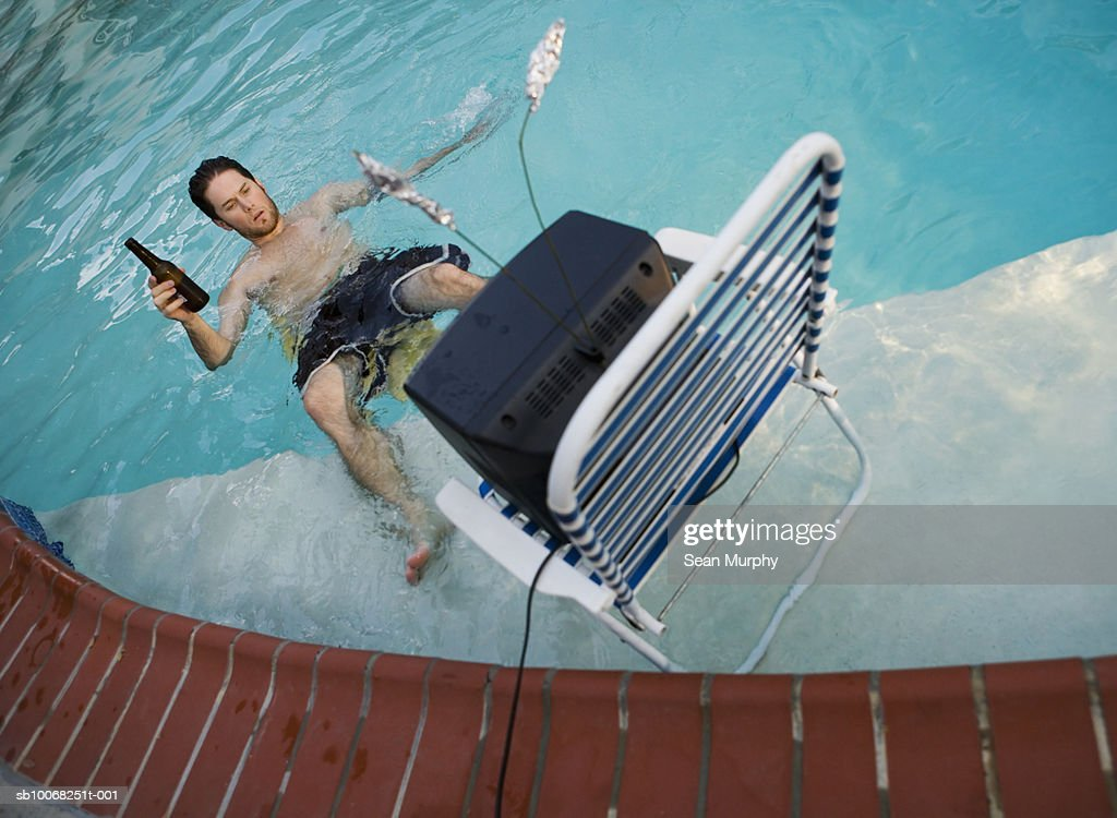Man Watching Tv In Swimming Pool Drinking Beer Stock Photo Getty Images