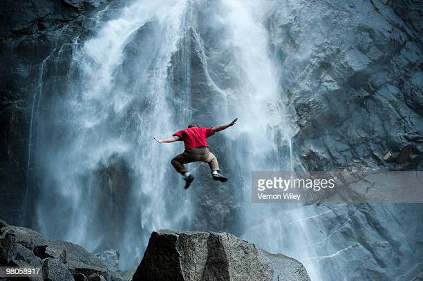 Man watching waterfall