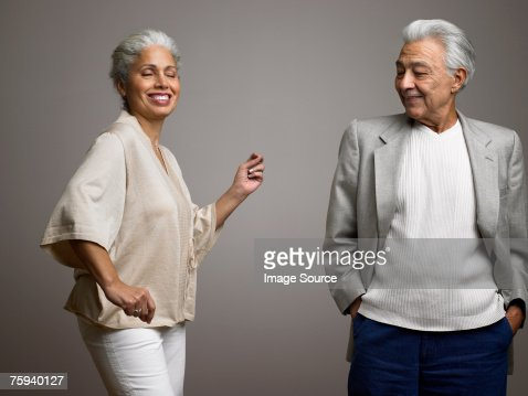 Man watching wife dance