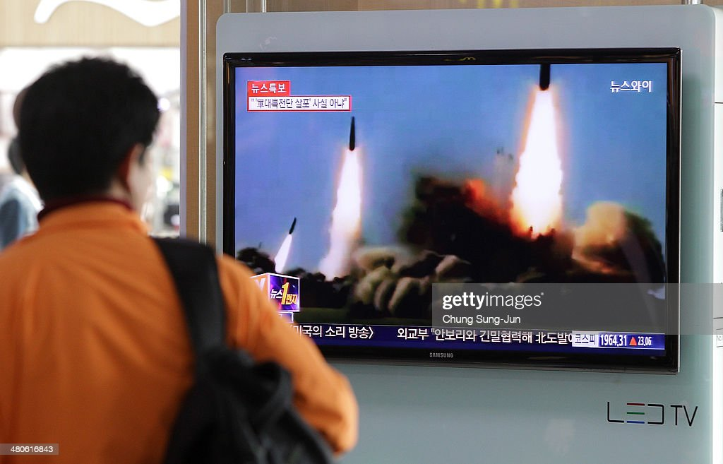A Man watchs a television broadcast reporting the North Korean missile launch at the Seoul Railway Station on March 26, 2014 in Seoul, South Korea. North Korea test-launched two Nodong medium-range ballistic missiles into the sea off Korean peninsula's east coast on Wednesday morning, according to South Korea's defence ministry.