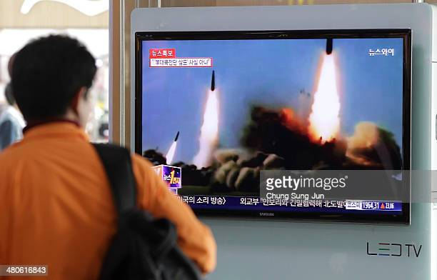 Man watchs a television broadcast reporting the North Korean missile launch at the Seoul Railway Station on March 26 2014 in Seoul South Korea North...