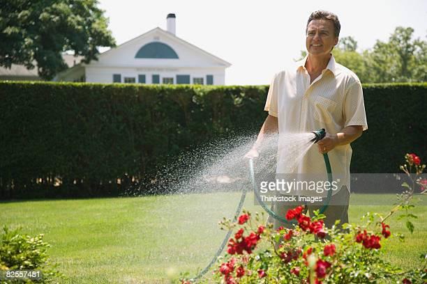 Man watering yard