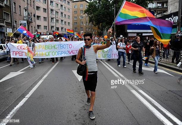 A man waves a flag during the third Sofia Gay pride marsch in Bulgarian capital Sofia on June 26 2010 Hundreds of gays lesbians and transsexuals...