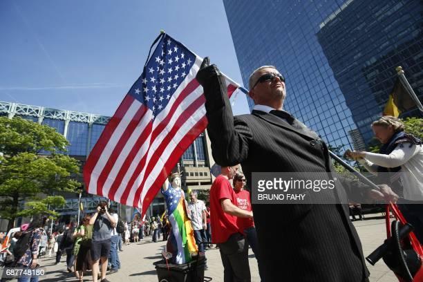 A man waves a US flag during a protest march against the US president and the Belgian Prime Minister in the city center of Brussels on May 24 2017 US...