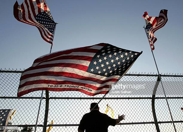 A man waves a US flag on a freeway overpass on Highway 24 September 11 2006 in Lafayette California A group calling themselves the Lafayette Flag...