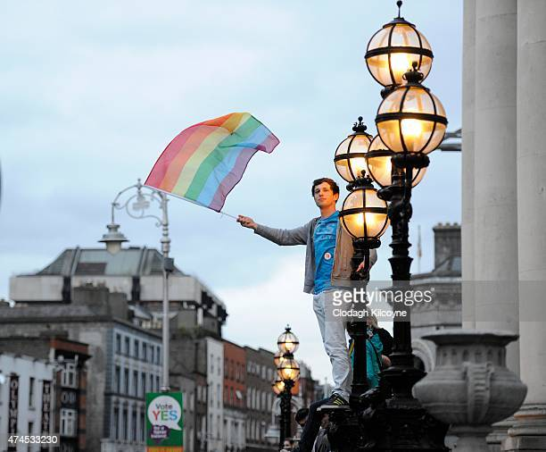 A man waves the rainbow colored flag as he celebrates a landslide victory of a Yes vote after a referendum on same sex marriage was won by popular...