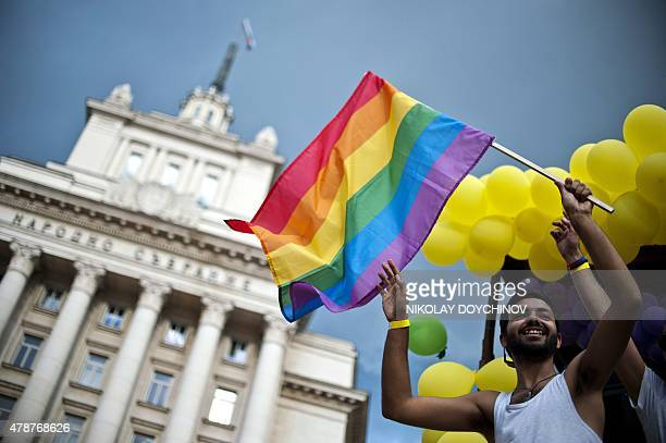 A man waves the Rainbow flag on a truck during the annual Gay Pride parade in central Sofia on June 27 as people march through the Bulgarian capital...
