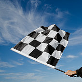 Man waving checkered flag (blurred motion)