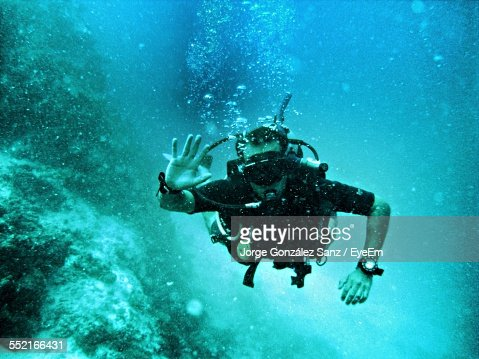 Man Waving Underwater