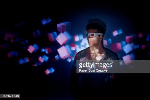 man wearing 3D glasses, looking at 3D projection : Stock Photo