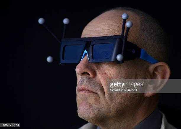 A man wearing 3D glasses takes part in a demonstration of a CAD stereoscopic and interactive projection system at the Industrial Centre for Virtual...