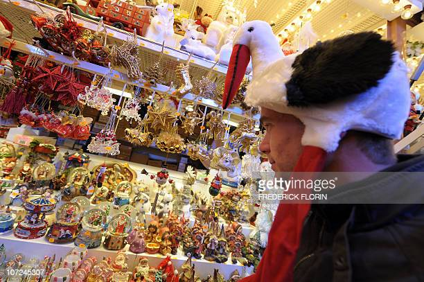 A man wearing a a white stork on his head looks at Christmas decorations on November 27 2010 during the opening of the Strasbourg Christmas market...
