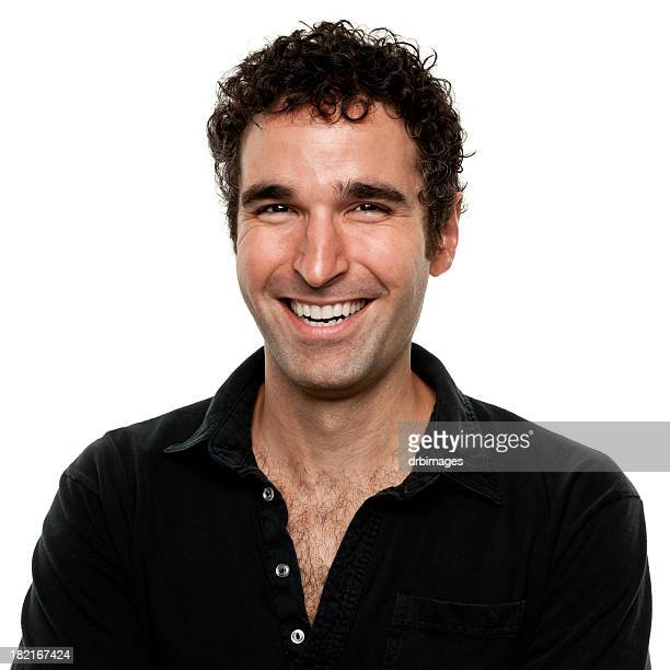 Man wearing a black shirt smiling for a portrait