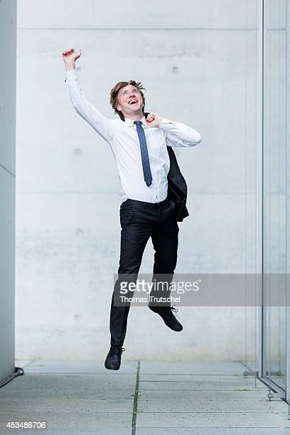 A man wearing a business suit jumps into the air on August 07 2014 in Berlin Germany