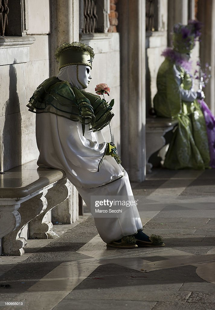 A man wearing a carnival costume poses is Saint Mark's Square on February 8, 2013 in Venice, Italy. The 2013 Carnival of Venice runs from January 26 - February 12 and includes a program of gala dinners, parades, dances, masked balls and music events.