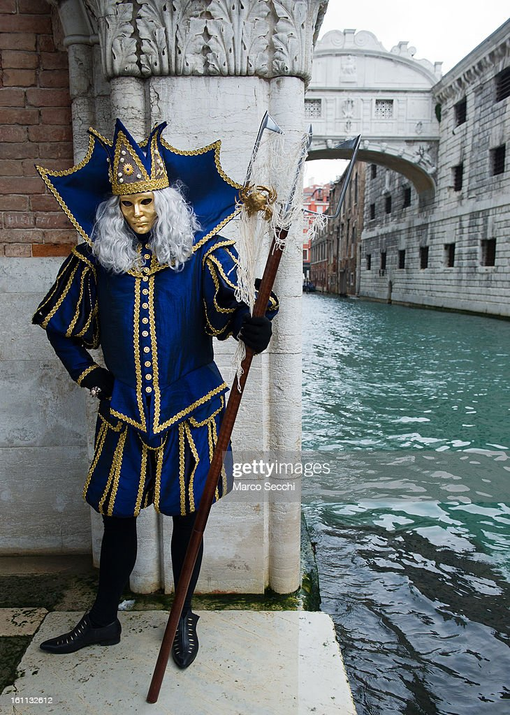 A man wearing a Carnival Costumes pose in front of the Bridge of Sigh on February 9, 2013 in Venice, Italy. The 2013 Carnival of Venice runs from January 26 - February 12 and includes a program of gala dinners, parades, dances, masked balls and music events.