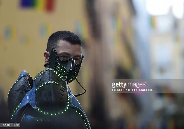 A man wearing a costume attends the launch of the Gay Pride in Madrid on July 2 2014 AFP PHOTO / PIERREPHILIPPE MARCOU