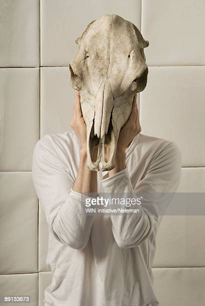 Man wearing a cow's skull, Buenos Aires, Argentina