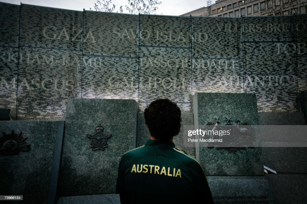A man wearing a cricket shirt looks at the Australian War Memorial on April 25, 2007 in London. The yearly ANZAC memorial service remembers the soldiers of Australia and New Zealand who fought in the two World Wars and came into being after the heroic campaign that followed the landings at ANZAC Cove in Gallipoli on April 25, 1915 in which the Allies lost 50,000 casualties in their battle with Turkish forces. The new memorial on Hyde Park Corner in central London is engraved with 24,000 names of the hometowns of Australian men and women who served in the two World Wars. Superimposed on these place names are 47 battle sites representing some of the major theatres of war where Australians served.