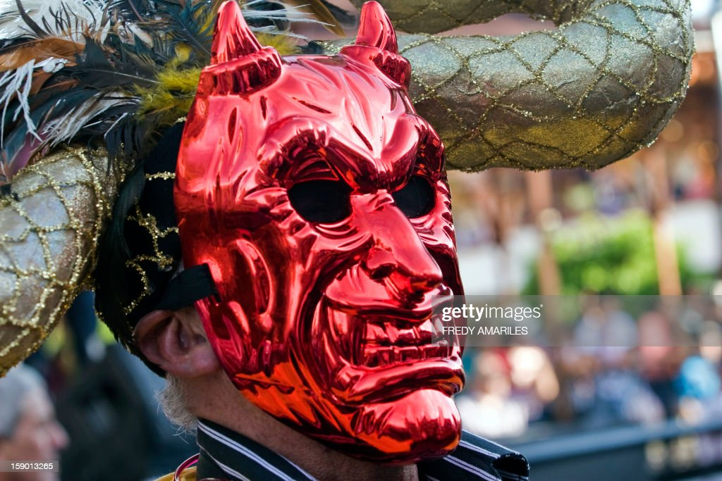 A man wearing a devil mask takes part in the Devil's Carnival in Riosucio, Caldas department, Colombia on January 5, 2013. Riosucio's Carnival was proclaimed by UNESCO as a cultural intangible heritage and takes place every two years. AFP PHOTO/Fredy AMARILES