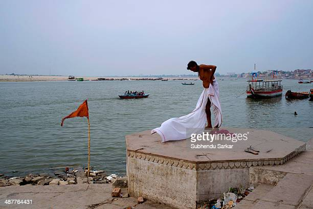 A man wearing a dhoti after bathing in the Ganges in Varanasi Varanasi is a holy city on the banks of the Ganges