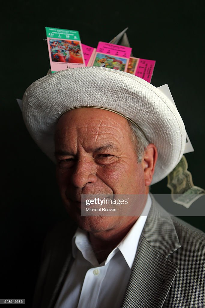 A man wearing a festive hat poses prior to the 142nd running of the Kentucky Oaks at Churchill Downs on May 06, 2016 in Louisville, Kentucky.