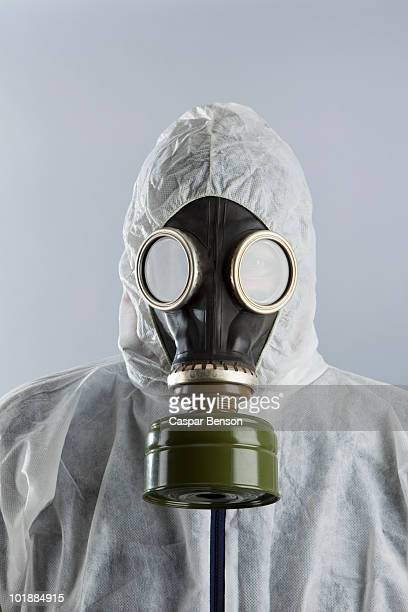 A man wearing a gas mask and protective suit