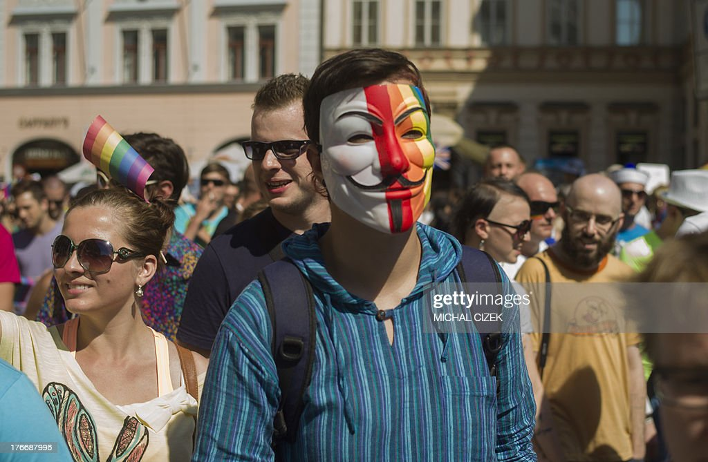 A man wearing a Guy Fawkes mask in rainbow colors takes part in the third gay pride festival in the Czech capital Prague on August 17, 2013.