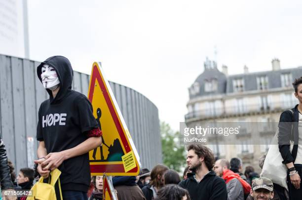 A man wearing a Guy Fawkes mask takes part in a demonstration for a quotsocial first roundquot of the French presidential election on April 22 2017...