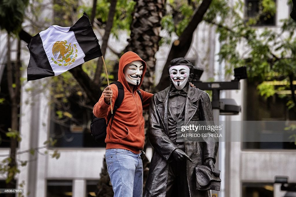 A man wearing a Guy Fawkes mask takes part in a protest demanding justice in the case of the 43 missing students, at the Reforma Avenue in Mexico City on December 26, 2014. The missing students disappeared on September 26th, when police in the city of Iguala attacked busloads of college students, allegedly under the orders of its mayor, and handed them over to a gang.